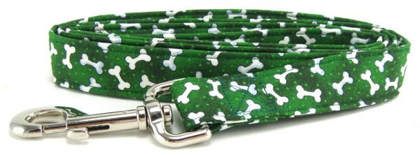 White tossed bones on green dog leash